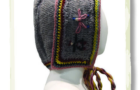 Bonnet knitted with worsted weight purple/grey wool