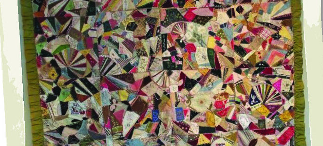Multi-coloured, with olive green silk back and a ruffled border, this crazy quilt dates from the 1880s.